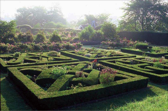 "A knot garden at Helmingham. Note the featured plants in the spaces created by the ""needlework""."